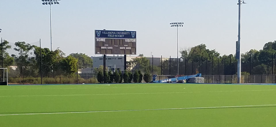 field hockey field with scoreboard in background